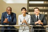 group of multiracial business people standing by stairway