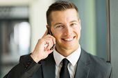 good looking business executive talking on mobile phone