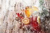 Christmas mull and punch on wooden table