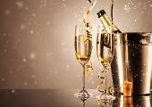Glasses of champagne with ribbons and bubbles around. Concept of celebration