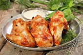 Baked Chicken Wings With Sauce On Wooden Table