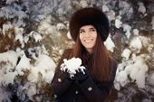 Young Woman Playing with Snow Winter Portrait