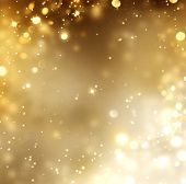 Christmas Gold Background. Golden Holiday glowing Abstract Glitter Defocused Background With Blinking Stars. Blurred Bokeh