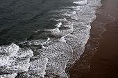 Waves Breaking On A Sandy Beach