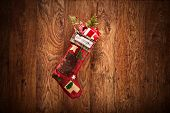Christmas stocking hanging on a wooden surface