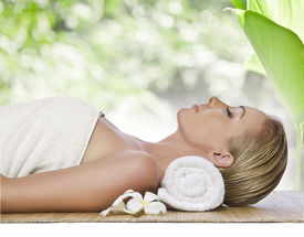 foto of spa massage  - portrait of young beautiful woman in spa environment - JPG