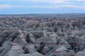 picture of butts  - Landscape view of the Badlands National Park in South Dakota showing the topography of the eroded rock forming buttes and pinnacles with exposed rock strata in layers