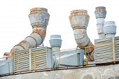 picture of exhaust pipes  - Industrial shot with big exhaust pipes on the roof of a plant - JPG