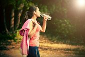 pic of bottle water  - a girl drinks water after sport - JPG