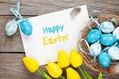 picture of egg whites  - Easter greeting card with blue and white eggs and yellow tulips over wood - JPG