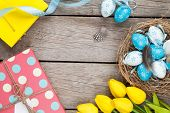 stock photo of nesting box  - Easter background with blue and white eggs in nest - JPG