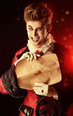 stock photo of dracula  - Attractive and frightening vampire holding a Sheepskin Scroll - JPG