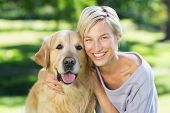 foto of dog park  - Pretty blonde with her dog in the park on a sunny day - JPG