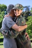 stock photo of reunited  - Soldier reunited with her father on a sunny day - JPG
