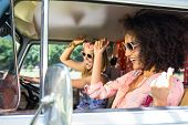 stock photo of friendship  - Happy friends on a road trip on a summers day - JPG
