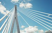 stock photo of skyway bridge  - fragment of a cable stayed bridge on the sky background - JPG