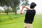 image of take off clothes  - Golfer teeing off at the golf course - JPG