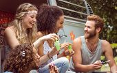 stock photo of camper-van  - Hipsters blowing bubbles in camper van on a summers day - JPG