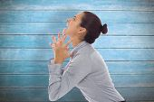 stock photo of frustrated  - Frustrated businesswoman shouting against wooden planks - JPG