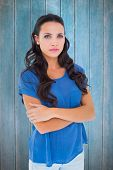 pic of frown  - Angry brunette frowning at camera against wooden planks - JPG