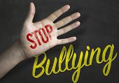 foto of stop bully  - Stop Bullying educacional message on blackboard - JPG