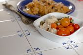 foto of pickled vegetables  - Salad of pickled vegetables in white bowl and sauerkraut with meat in plate - JPG