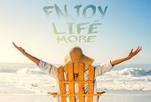 pic of sea life  - Woman relaxing in deck chair by the sea against enjoy life more - JPG