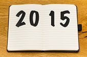 foto of fresh start  - Empty pages of a notebook for 2015 - JPG