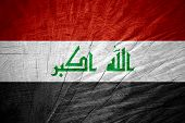 stock photo of iraq  - Iraq flag or Iraqi banner on wooden texture - JPG