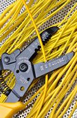 stock photo of stripper  - Strippers electrical tool with yellow electrical wires - JPG