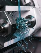 picture of lube  - Close up of Blue Floating Fluid in a machine - JPG