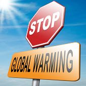 stock photo of wind-power  - stop global warming and use renewable energy and go green with solar power and wind power to avoid climate change - JPG