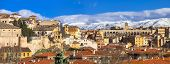 picture of aqueduct  -  panoramic view of Segovia with aqueduct and mountains - JPG