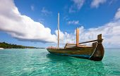 picture of kuramathi  - Longtail boat on the water - JPG