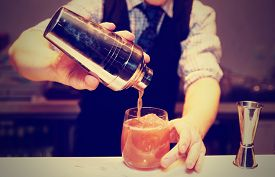 image of labor  - Bartender is making cocktail at bar counter - JPG