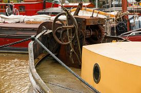 foto of safe haven  - Old boat equipment on fore deck ship - JPG