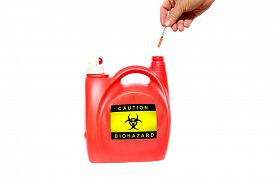 stock photo of bio-hazard  - A home made Needle and Sharps Disposal Container made from an old laundry soap dispenser - JPG