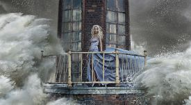 image of sea life  - Young blonde woman on the sea storm - JPG