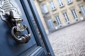 pic of mansion  - Bronze knocker of an old mansion in Bordeaux France