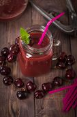 pic of cherries  - homemade cherries drink with fresh cherry on wooden table - JPG