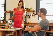 foto of breakfast  - Indoor shot of couple having breakfast in kitchen - JPG