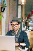 image of internet-cafe  - Fashionable and stylish young man relaxing with coffee music and internet browsing at the cafe bar - JPG