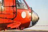 picture of military helicopter  - Orange military helicopter at the airport closeup - JPG