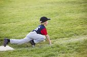 stock photo of sprinter  - Young boy baseball player waiting on third base - JPG