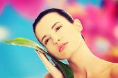 pic of bamboo leaves  - Beautiful woman with artistic make up and bamboo leaves - JPG