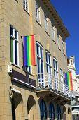 stock photo of gay flag  - Rainbow flag flying from a gay pride pub hotel bar in England - JPG