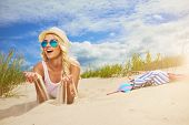 pic of funky  - Beach woman funky happy and colorful wearing sunglasses and beach hat having summer fun during travel holidays vacation - JPG