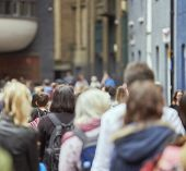 stock photo of pedestrians  - Cropped shot of busy sidewalk with anonymous pedestrians blurred - JPG