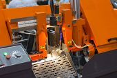stock photo of sawing  - band saw cutting tool steel bar by automatic feed - JPG