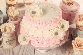 stock photo of sugarpaste  - Capture of delicious Pink Cake on wooden table - JPG